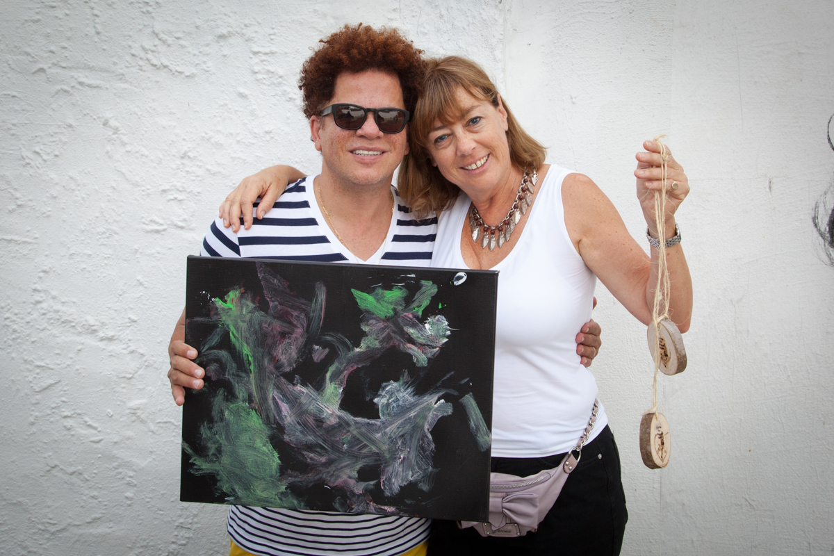 Romero Britto and Lindsey Matheson with Bubbles the Chimp's Painting